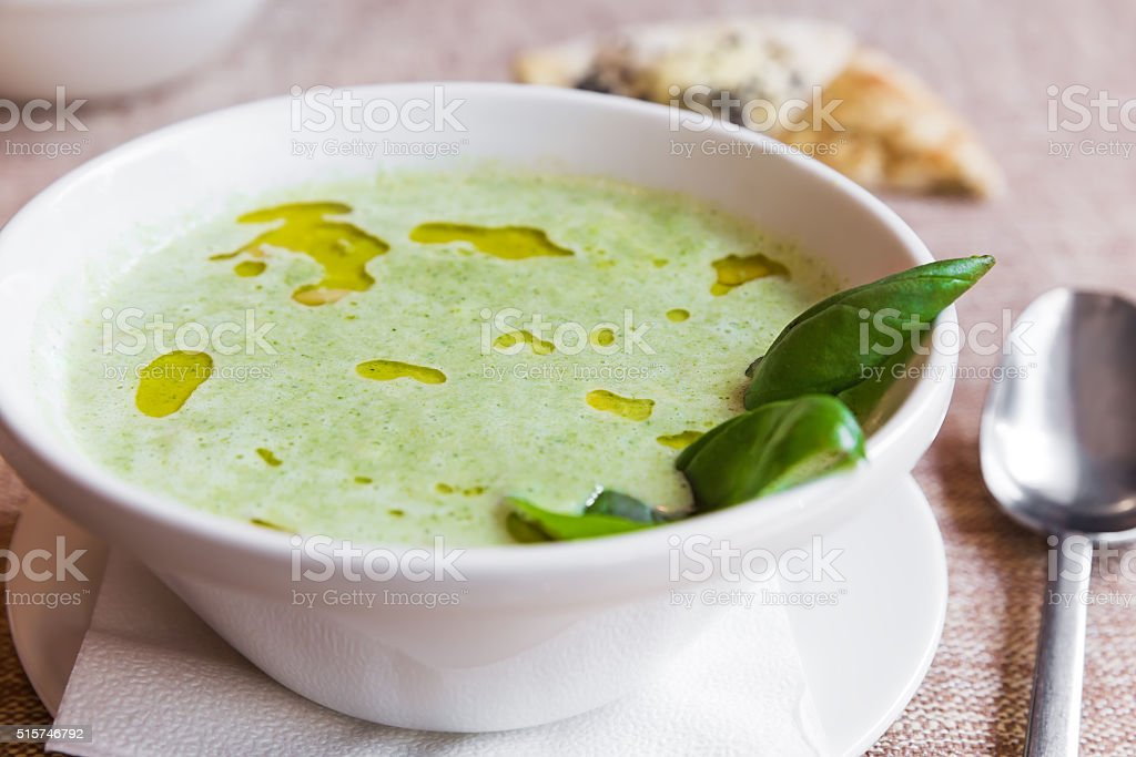 Broccoli and cheddar cheese cream soup stock photo