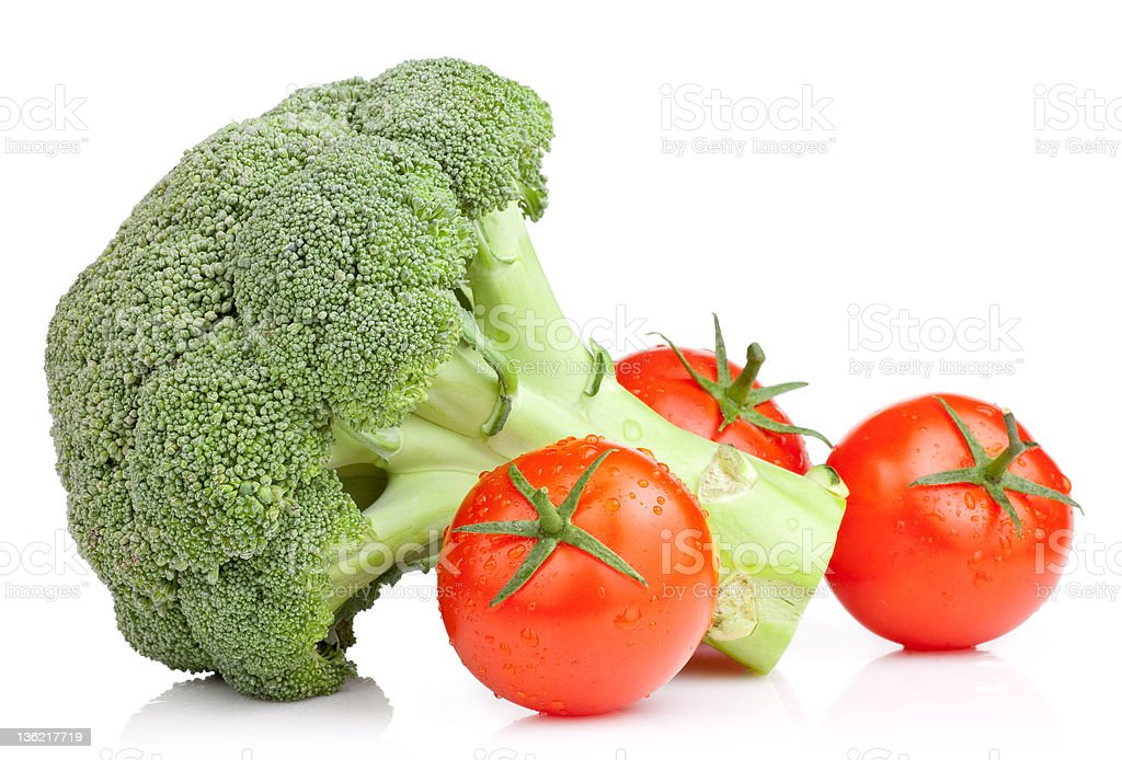 Broccoli and Three Tomato with drops Isolated on white background stock photo