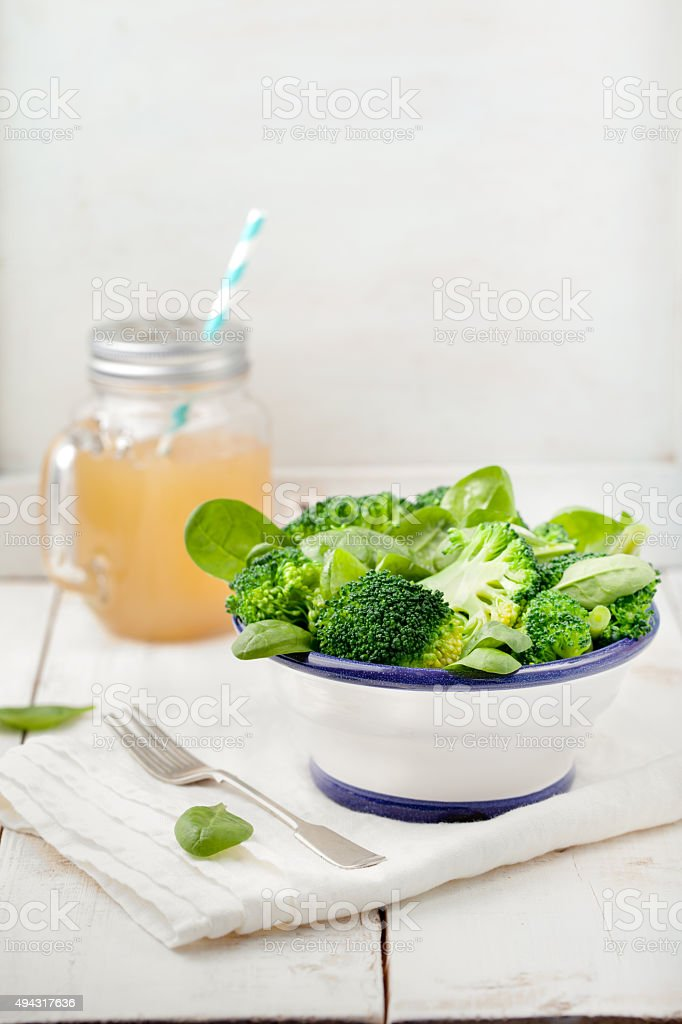 Broccoli, baby spinach and green beans salad stock photo