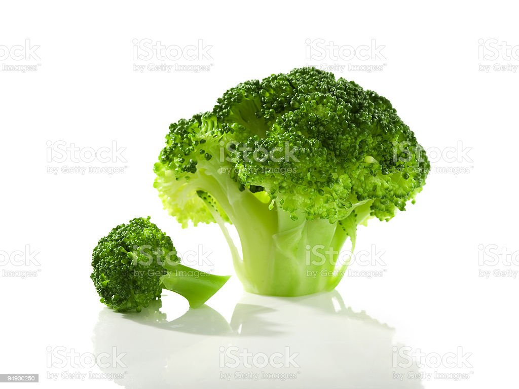 broccoli florets isolated stock photo