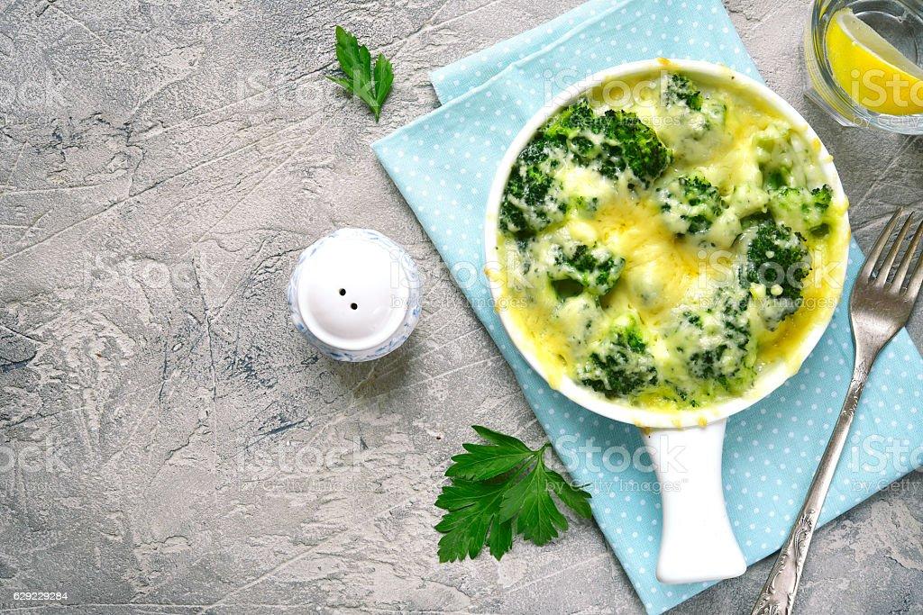 Broccoli gratin in a white baking dish stock photo