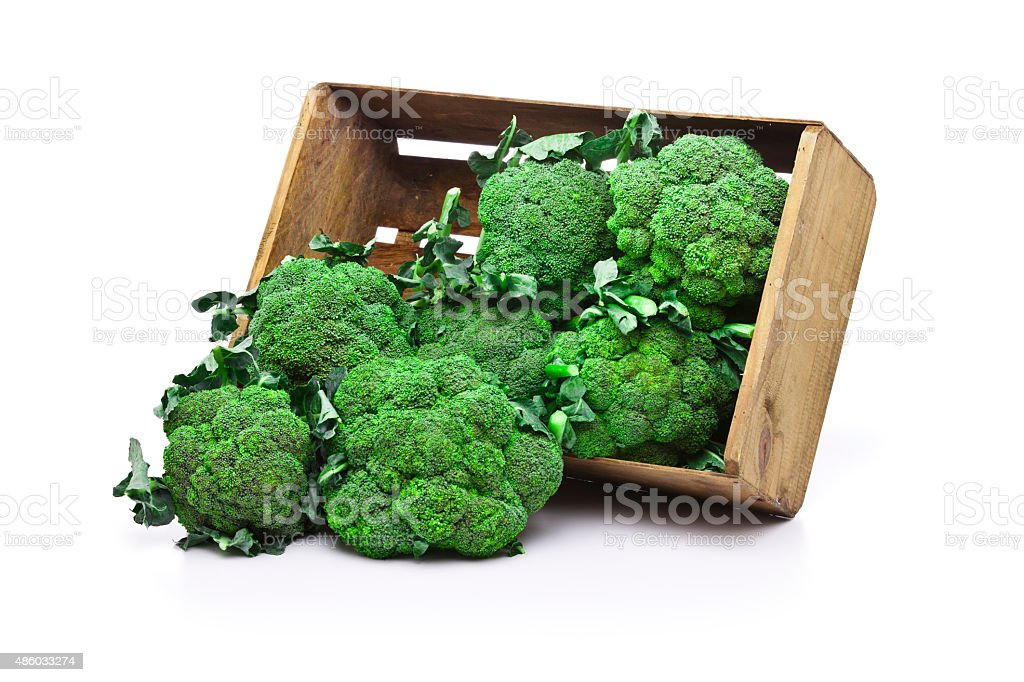 Broccoli in a wooden crate isolated on white background stock photo