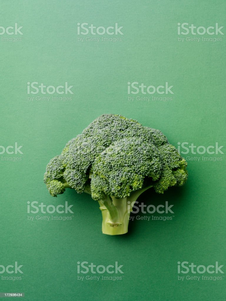 Broccoli on a Green Background royalty-free stock photo