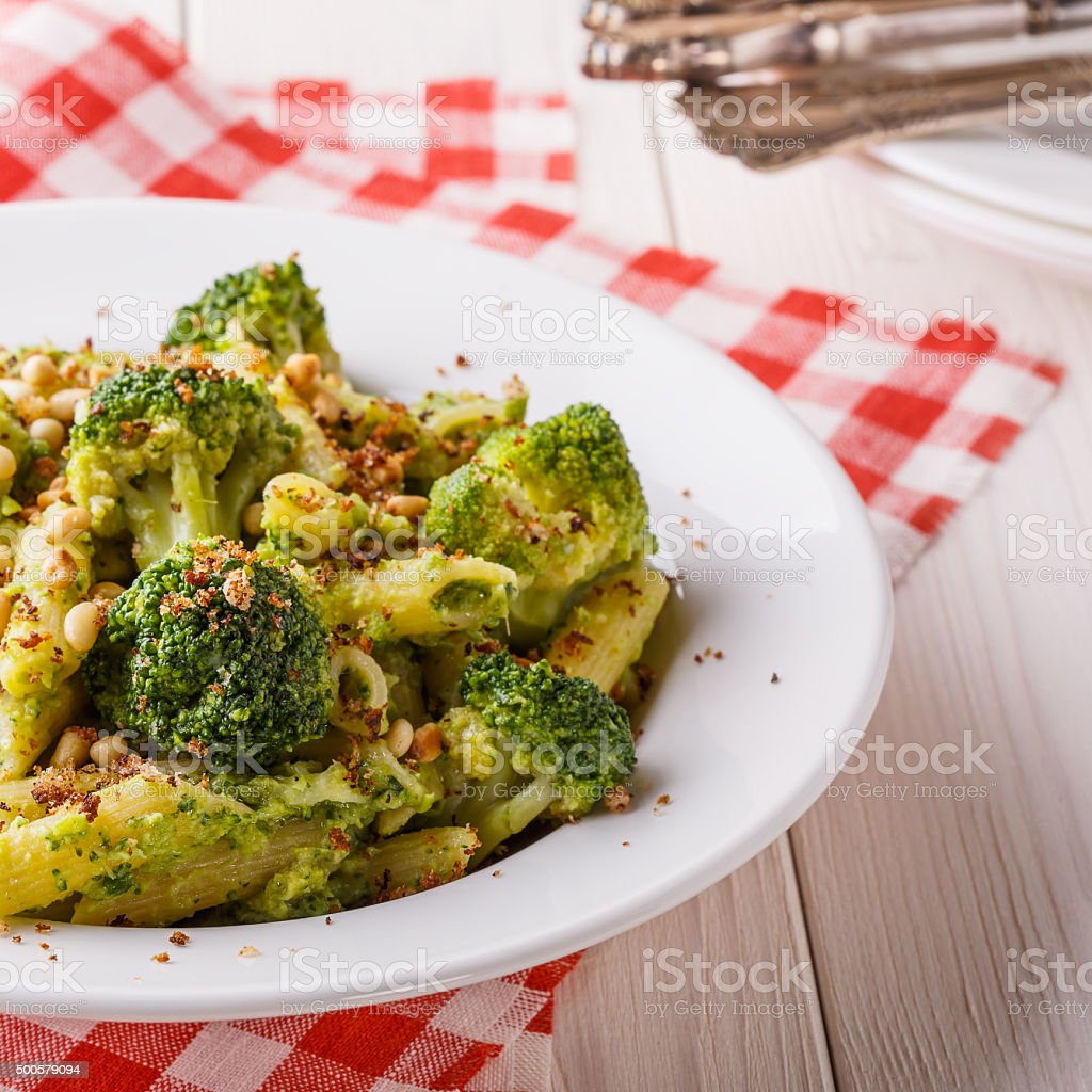 Broccoli pasta with sauce of green peas. stock photo