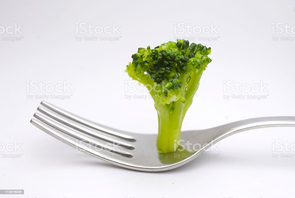Broccoli standing on fork stock photo