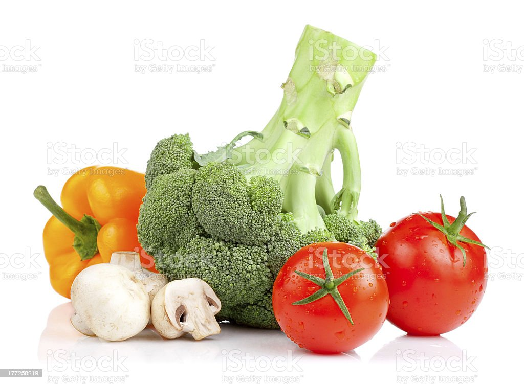 Broccoli, tomatoes, mushrooms and yellow pepper isolated on white background royalty-free stock photo