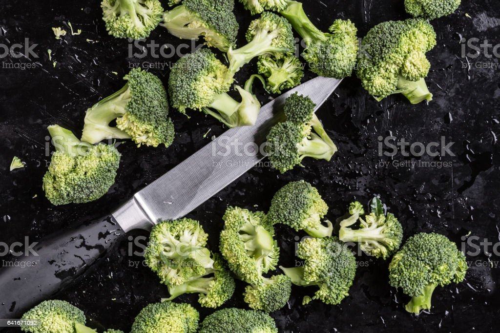 Broccoli with knife stock photo
