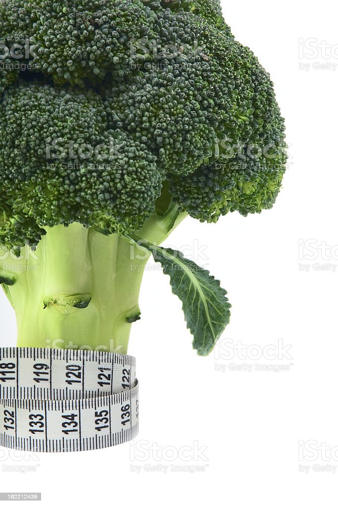 Broccoli with measure tape stock photo