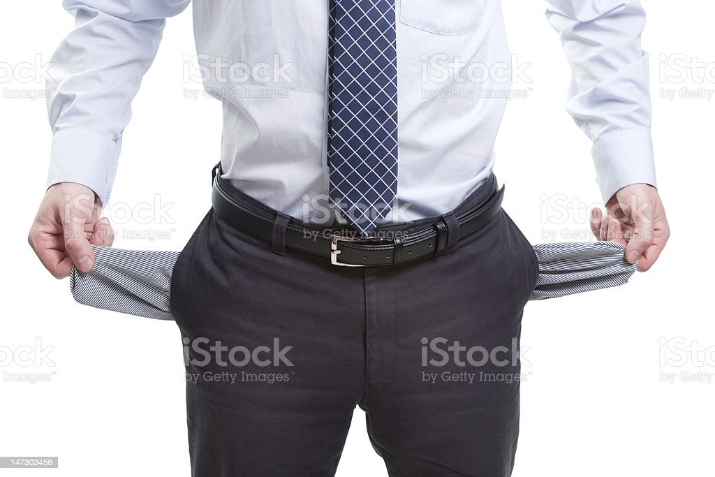 Broke and poor business man with empty pockets royalty-free stock photo