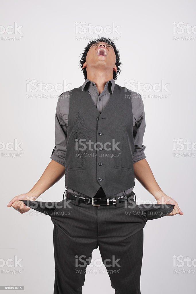 Broke businessman stock photo