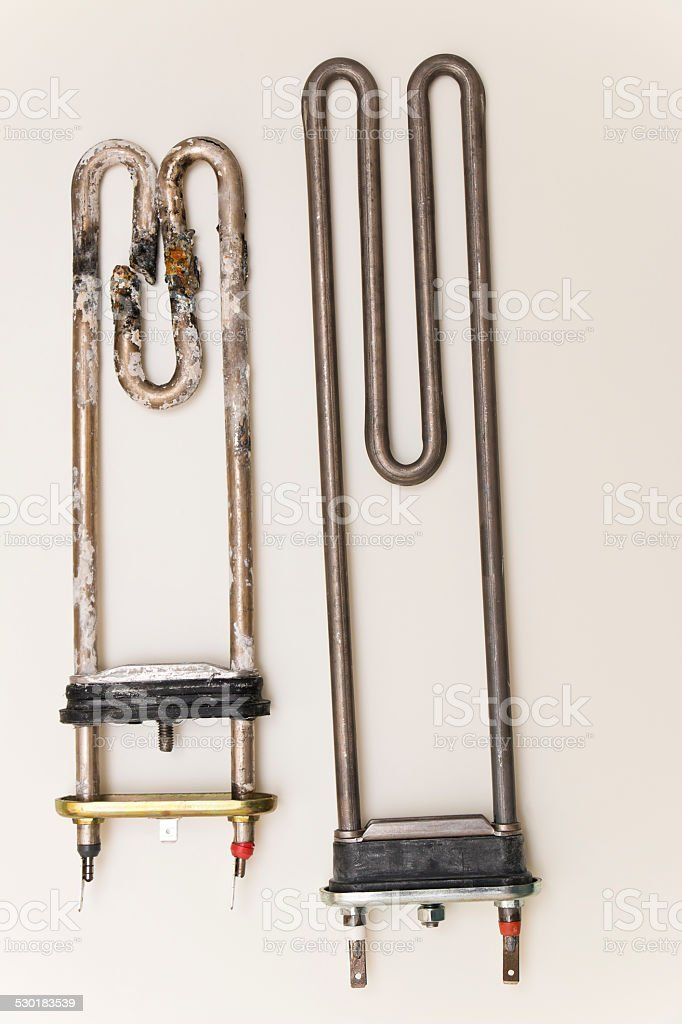 Broken and New Washing Machine Heater stock photo