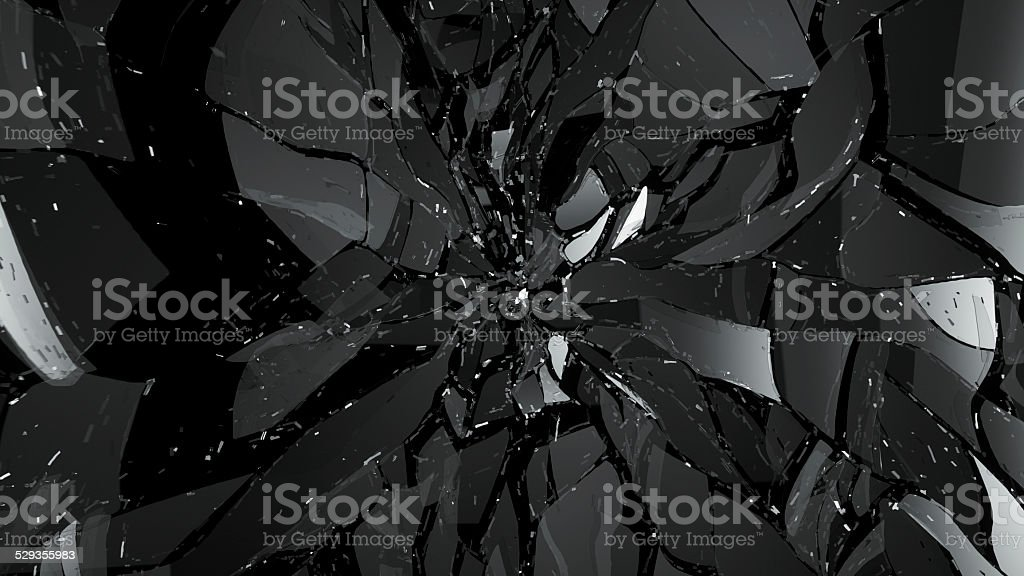 Broken and Shattered pieces of glass on black stock photo