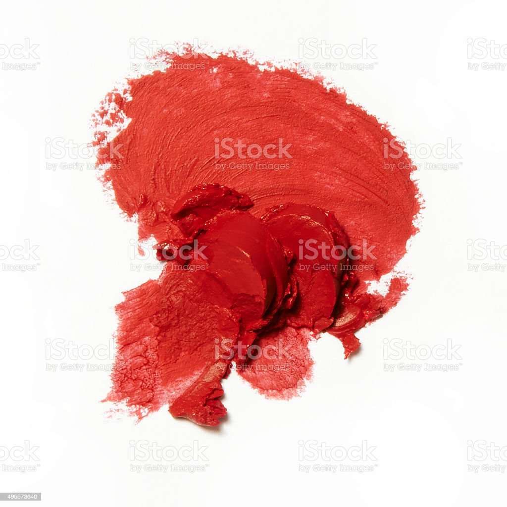broken and smashed red lipstick on white background stock photo
