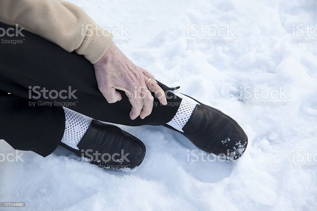 broken ankle after fall on snow stock photo