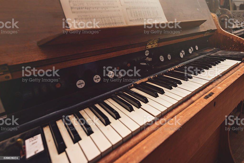 Broken antique piano stock photo