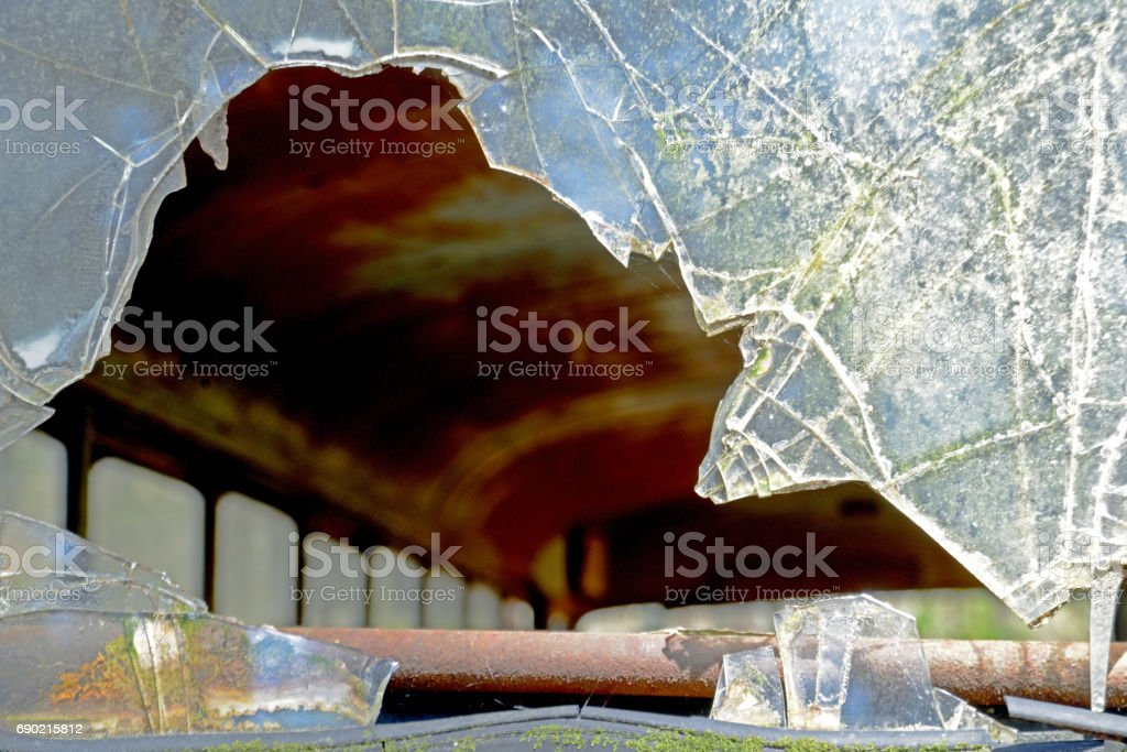Broken back glass in old abandoned bus. stock photo