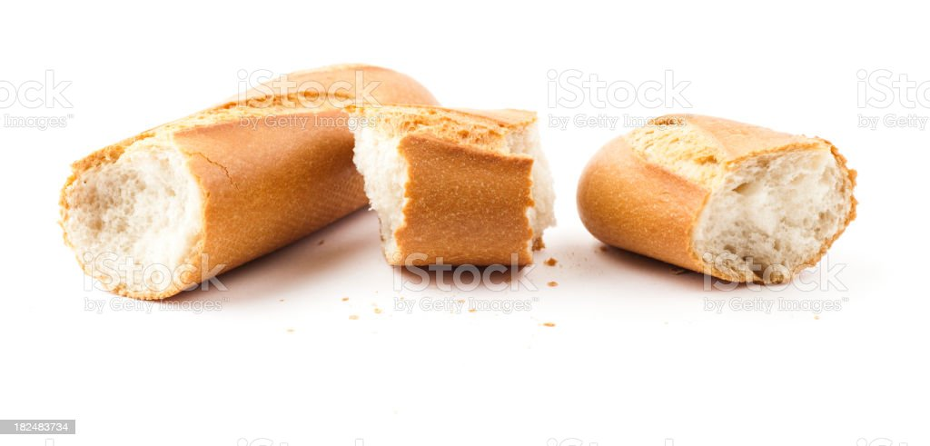 Broken baguette isolated on white royalty-free stock photo