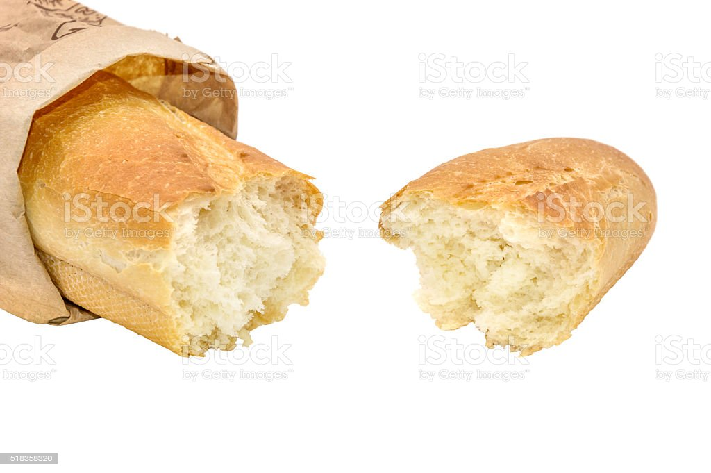 broken baguette isolated on white stock photo