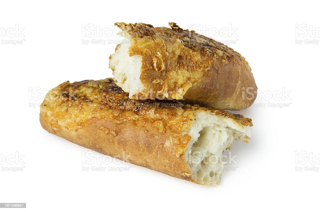 Broken baguette with cheese and garlic royalty-free stock photo