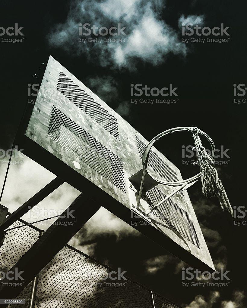 Broken basketball hoop in the city stock photo