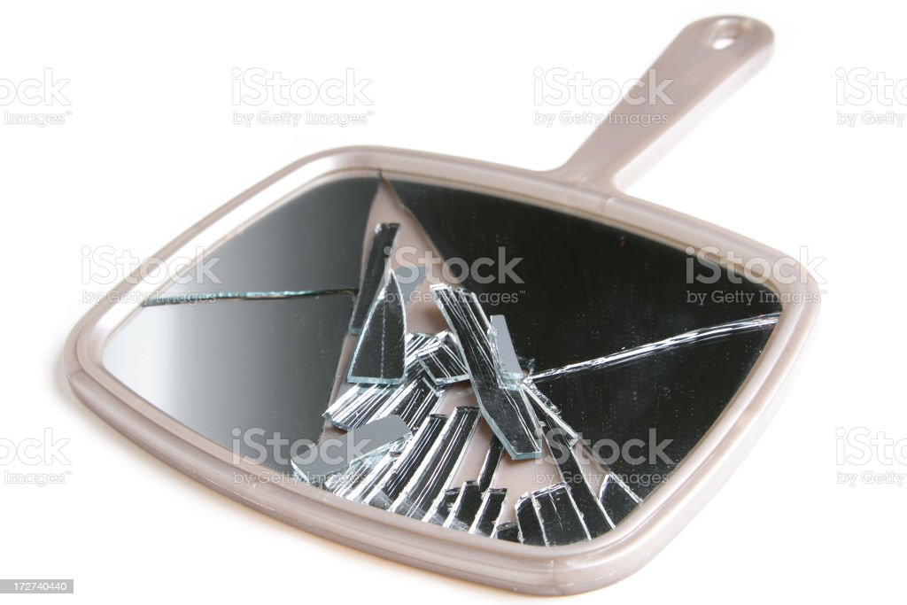 A broken beige hand held mirror on a white background stock photo