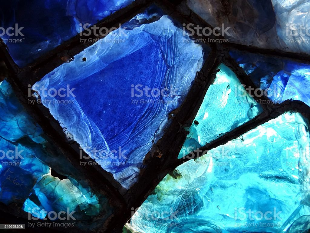 broken blue stained-glass window. stock photo