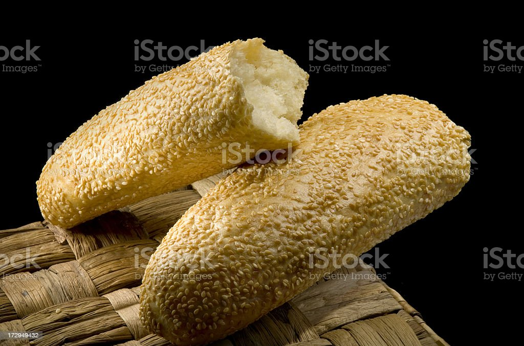 Broken bread on basket stock photo