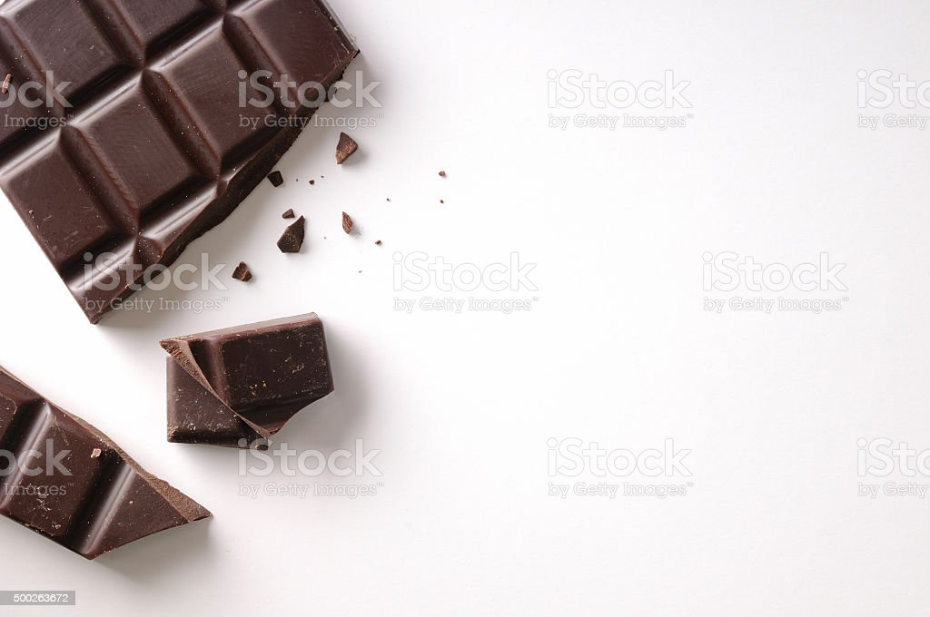 Broken chocolate bar left position isolated top view stock photo