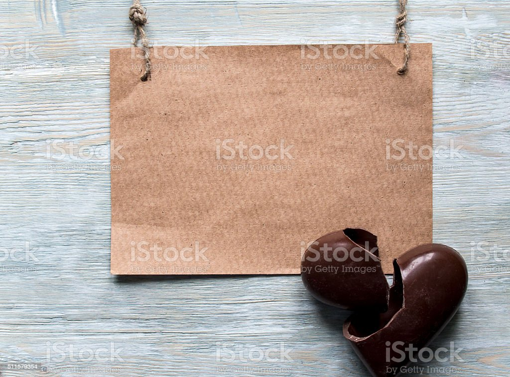 Broken chocolate heart and paper for note stock photo