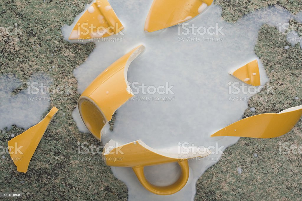 broken cup and spilled milk royalty-free stock photo