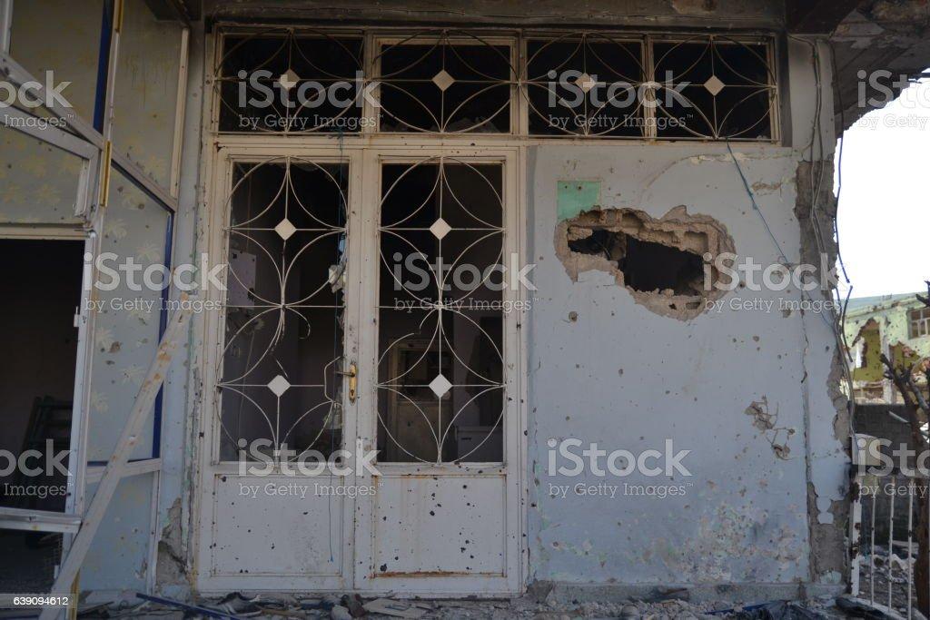 Broken door and Window with Gun Bullet-Riddle Hole stock photo