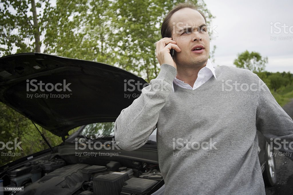 Broken Down Car on Side of Road with Man royalty-free stock photo