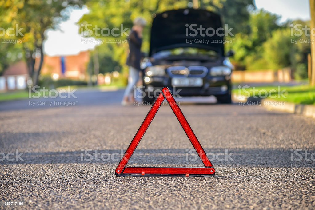 Broken down car on the road stock photo