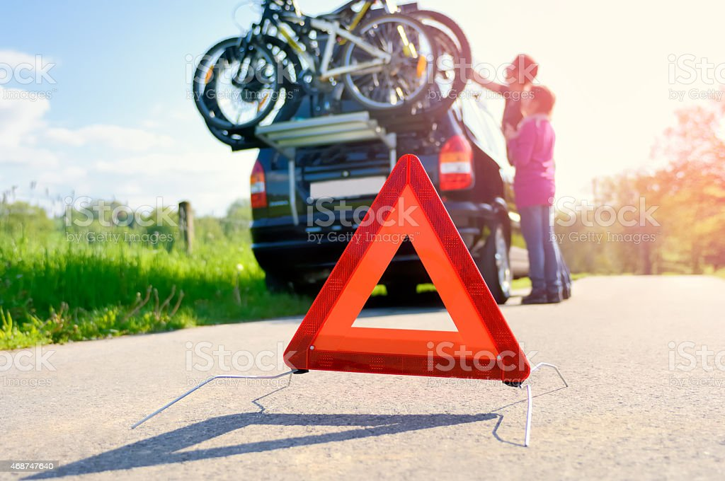 A broken down car with warning triangle  stock photo