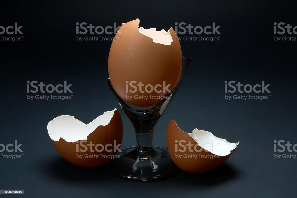 Broken eggs and glass royalty-free stock photo