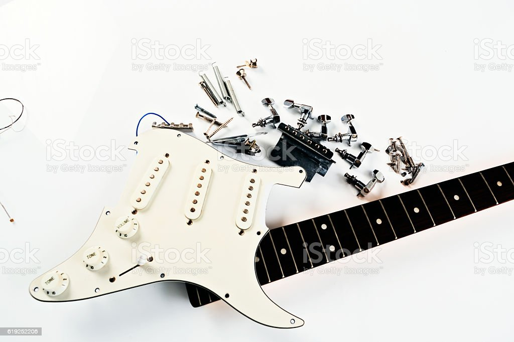 Broken electric guitar waits to be fixed stock photo