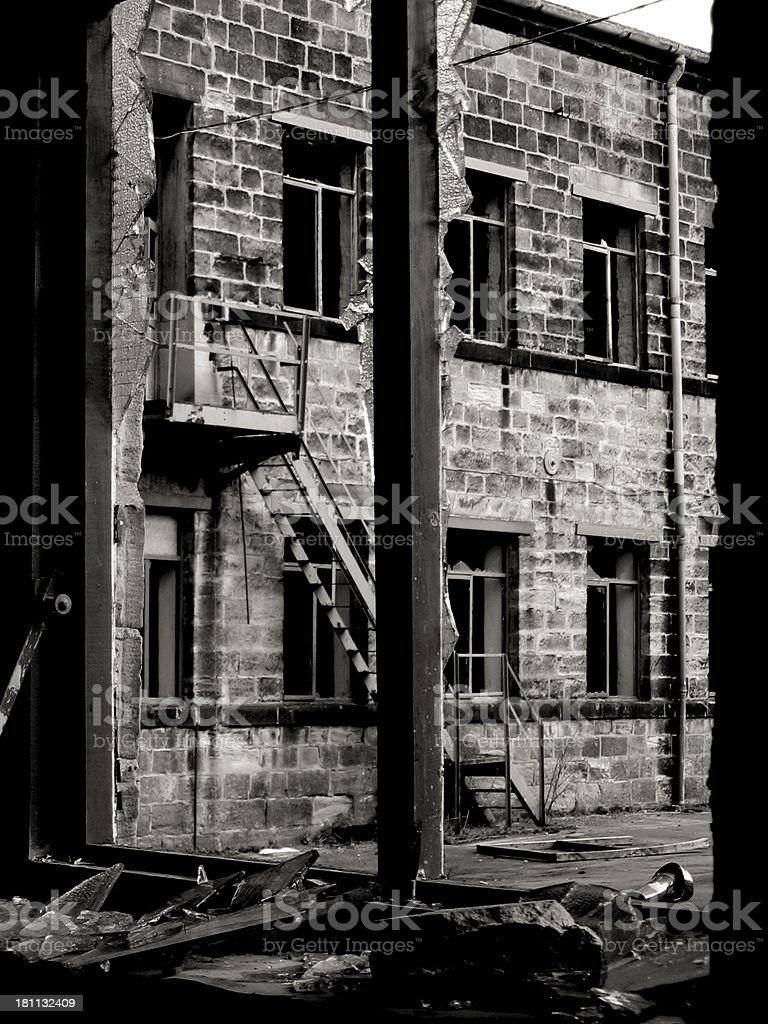 Broken factory windows showing urban decay royalty-free stock photo