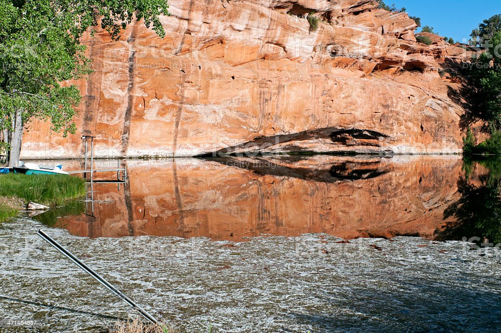 Broken fence at swimming pond in southern Utah stock photo