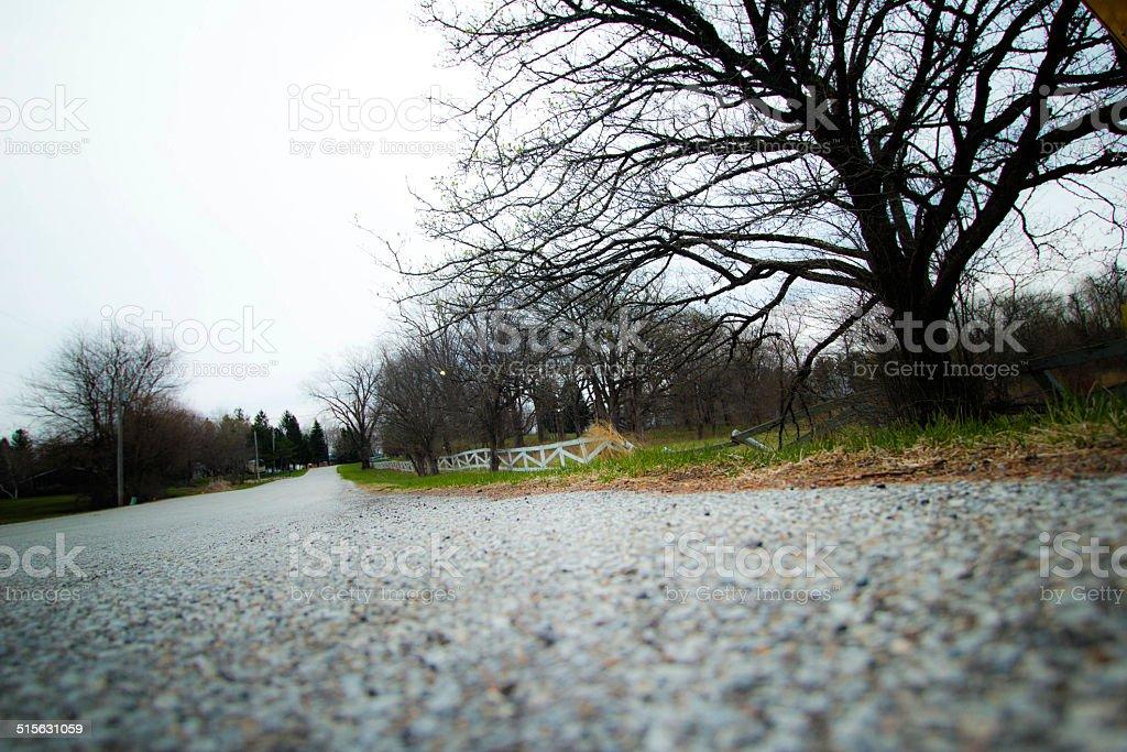 broken fence road stock photo