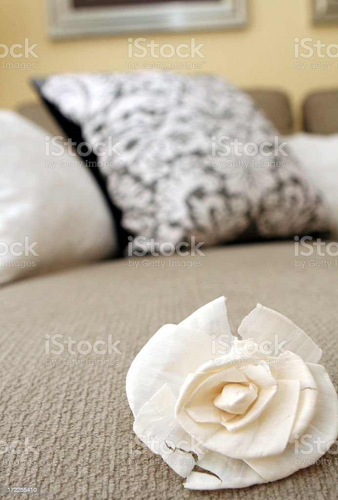 A broken flower on a hotel bed royalty-free stock photo