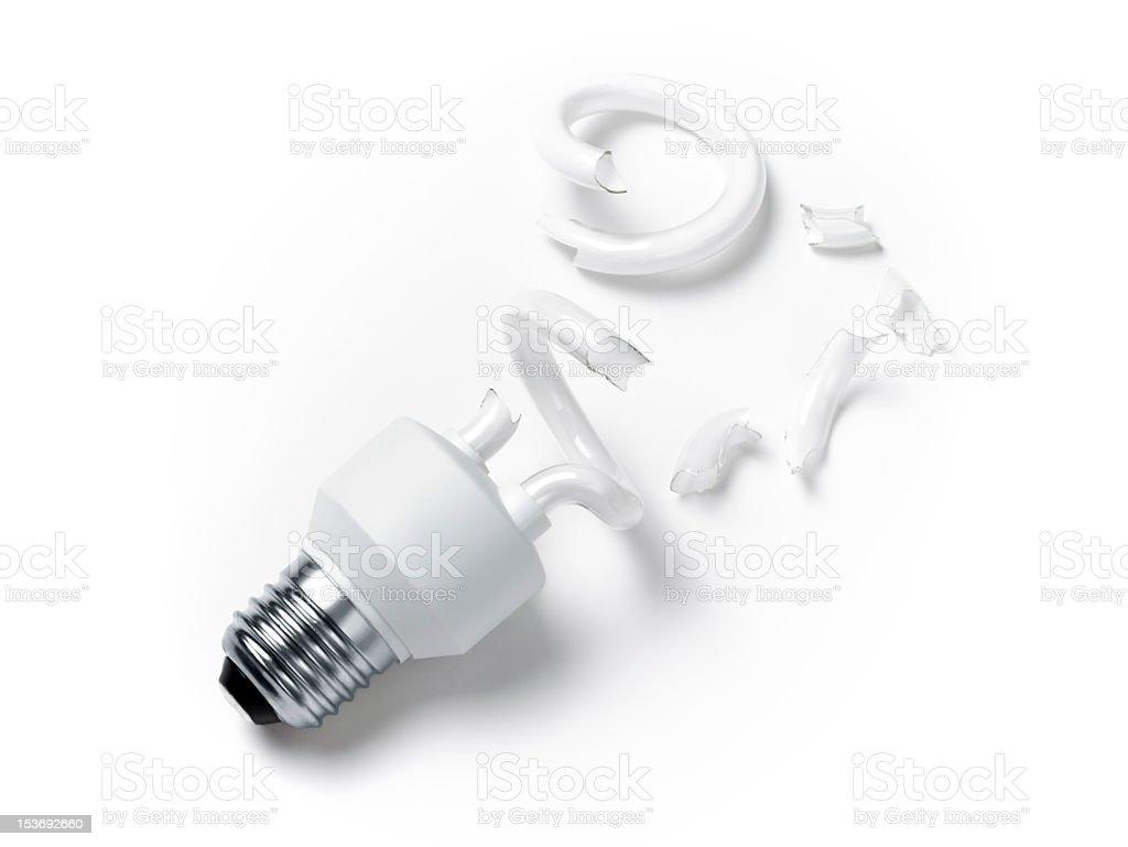 Broken fluorescent light bulb on white surface stock photo