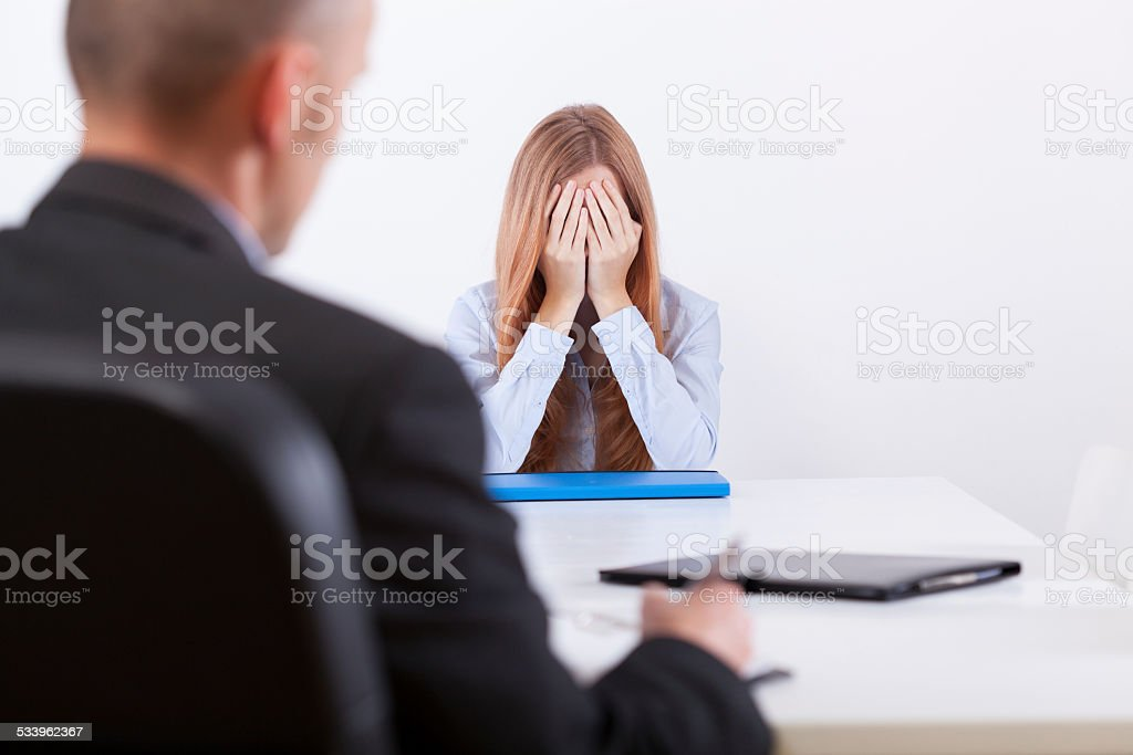 Broken girl during an interview stock photo