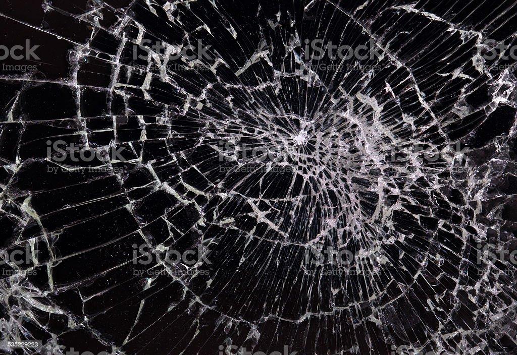 Broken glass, black background stock photo