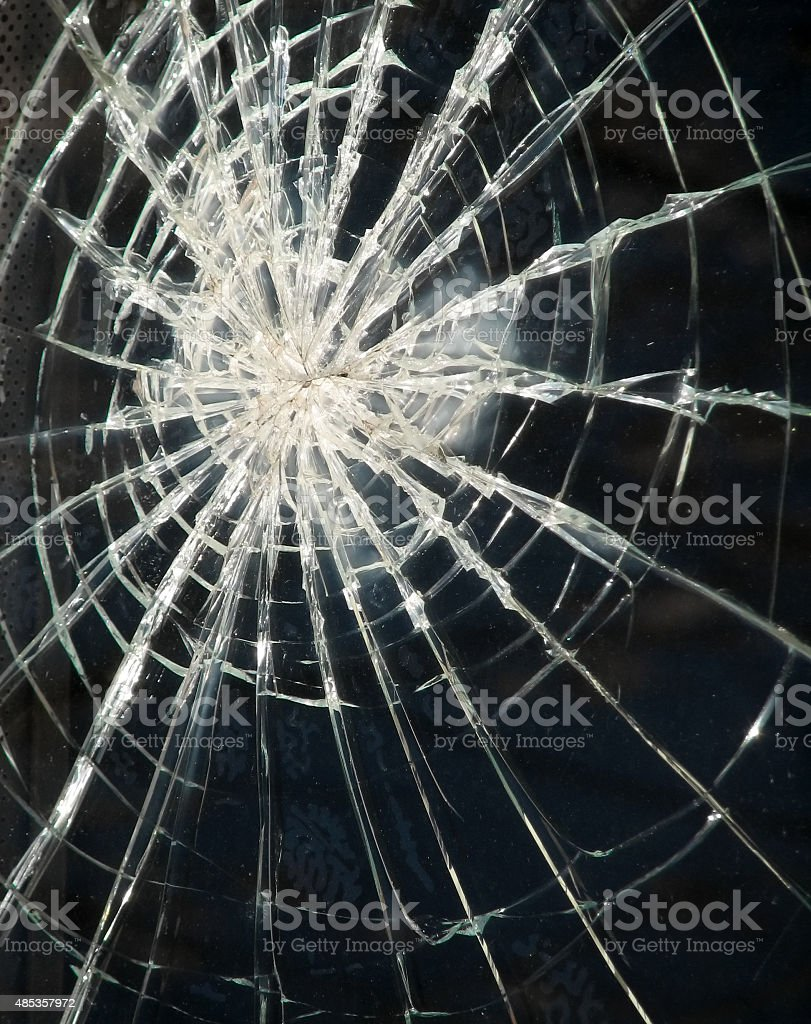 broken glass dark background stock photo