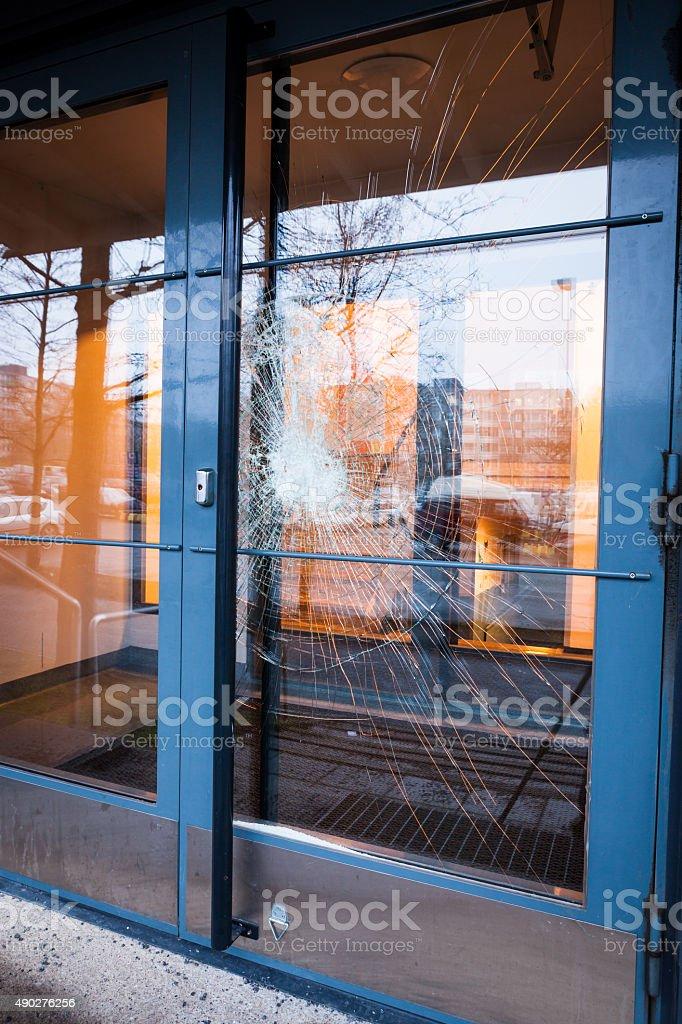 Broken glass front door stock photo