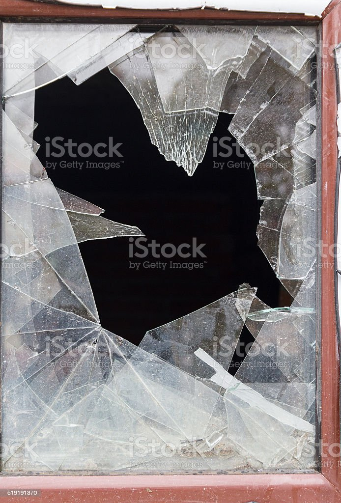 Broken glass in the close-up window stock photo