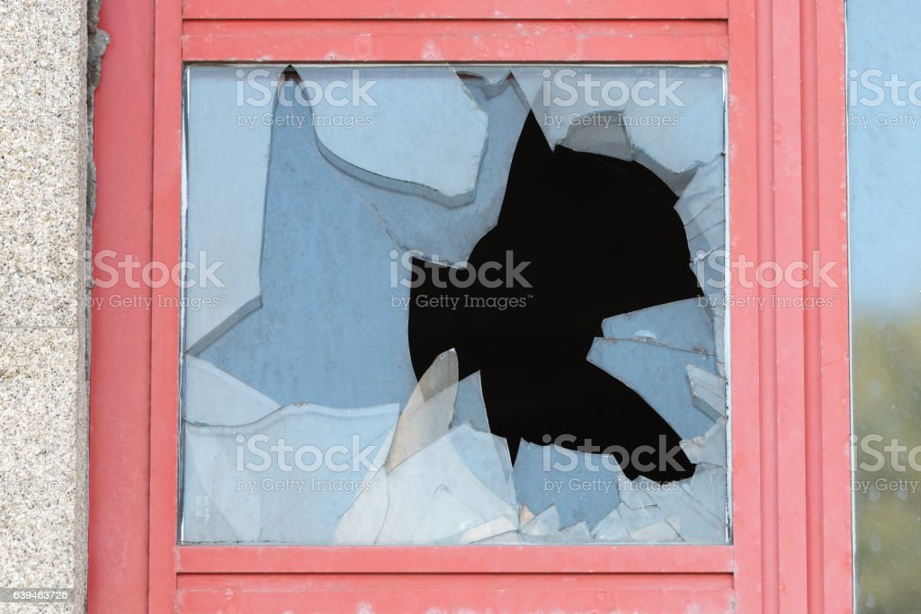 broken glass in the window stock photo