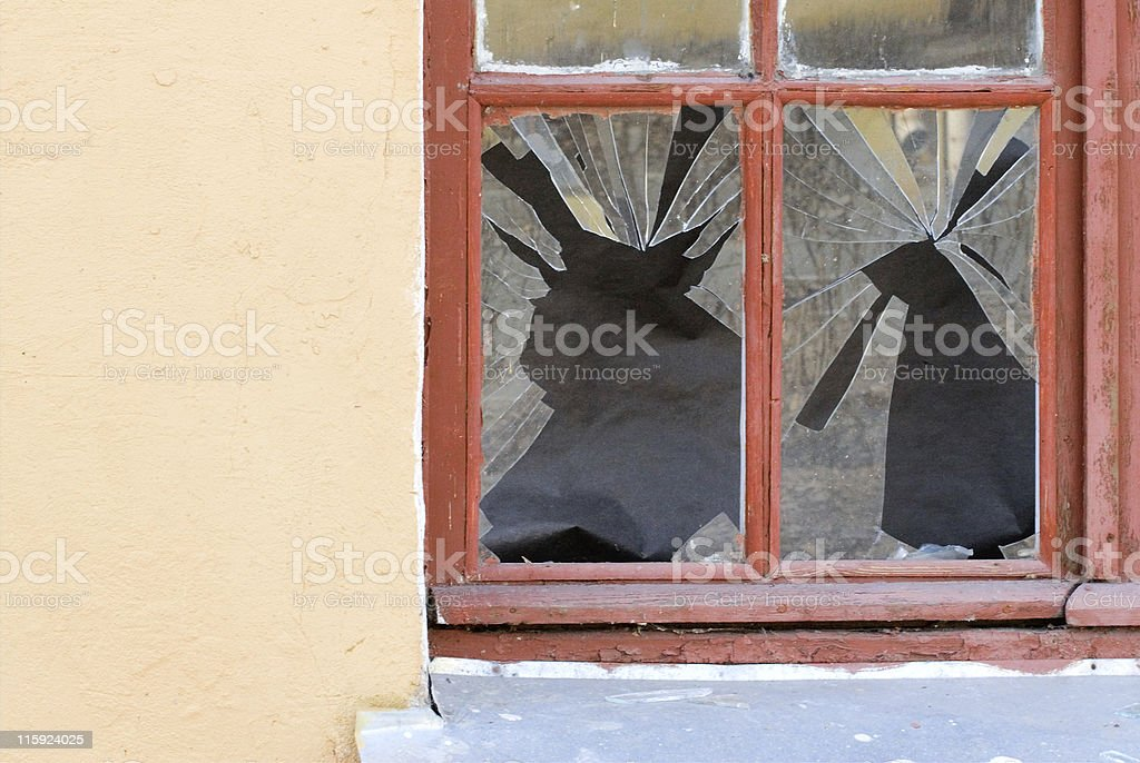 Broken glass in wooden window frame royalty-free stock photo