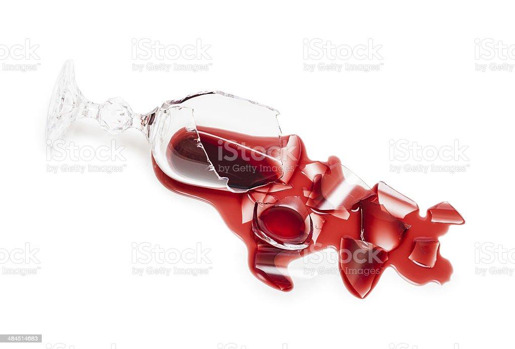 Broken glass of wine stock photo
