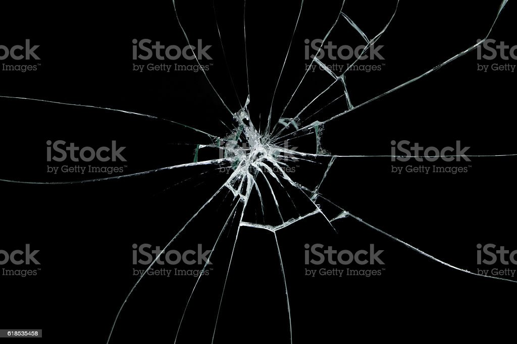 Broken glass on black background stock photo